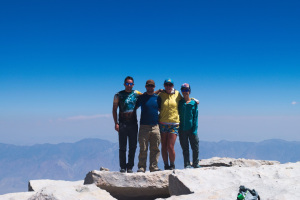 A group of hikers at the summit of Mt Whitney, California